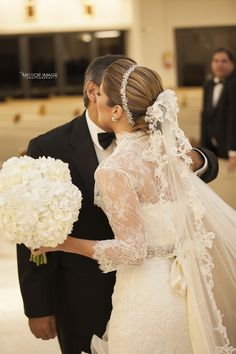 Bride wearing a Maria Elena Headpieces Swarovski Crystal Headband