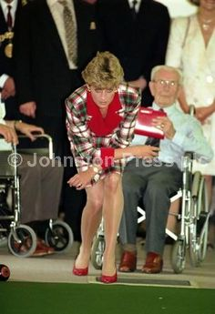 Princess Diana , Princess of Wales, tries carpet bowls during a visit to Erskine hospital in June 1992.