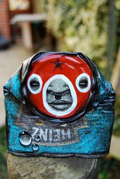Street Artist 'My Dog Sighs' Paints Faces on Cans Found Littered on the Street