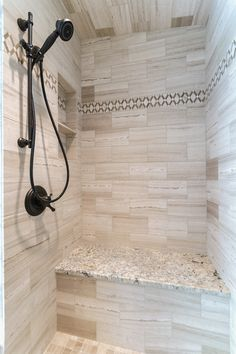 The built-in seat and shelves are a must have in a shower! www.lanebuilt.com