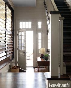 Louvered shutters that open into the living room lend a touch of British Colonial style to the entry.