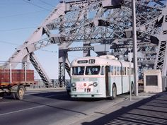 A trolley bus about to leave the Storey Bridge over the Brisbane River in the 1950's, in Queensland, Australia. Hard to believe it  now has 6 always packed lanes of traffic. The alternative is a 6.8 km tunnel under the river.