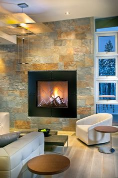 """New Mood Design have used a square gas supplied fire with a thick black frame. The back surrounding wall has been clad in slate. This is a truly modern design."""