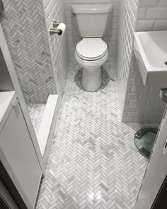 Love working with clients in New York City to create beautiful bathrooms. Herringbone & subway tile design is classic, simple and beautiful. Arabesque Tile Backsplash, Carrara Marble Bathroom, Hex Tile, Marble Floor, Tiling, Herringbone Subway Tile, Beveled Subway Tile, Herringbone Pattern, Shower Floor Tile