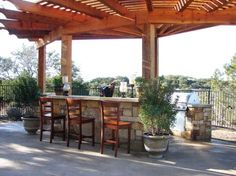 Outdoor kitchen islands create a useful and elegant place for food prep and backyard entertaining.
