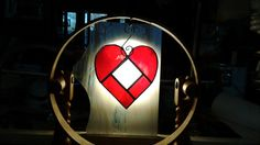 cute little stained glass heart suncatcher. center is beveled square glass measures 4 without hanger