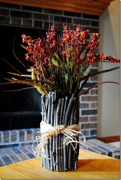 Twig Vase--Iowa Girl Eats.  http://iowagirleats.com/2011/10/15/no-cost-diy-decor/