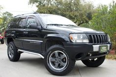 """2004 Grand Cherokee Laredo """"Freedom Edition"""" - Silver front fascia accent, Tubular side rails, 17-inch Rogue graphite-painted cast aluminum wheels, Bright silver roof rack, Front floor slush mats, and Its lifted!!! http://www.selectjeeps.com/inventory/view/7586854?2004+Jeep+Grand+Cherokee+4dr+Laredo+4WD+League+City+TX"""