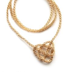 YOOLA sells a celtic knot heart made of delicate tube of crocheted gold-filled wire.