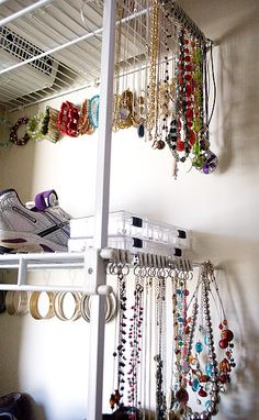 Ikea curtain hook rings for necklaces, and paperclips for bracelets. Pretty clever way to keep jewelry organized!