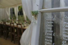 Old windows are great for seating plans and the handwriting makes for a personal touch.
