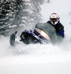 Enjoy The Snow By Indulging in  Snowmobiling