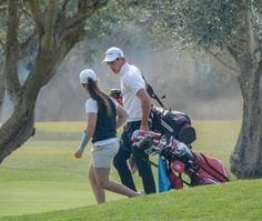 Two of Mallorca's great golfers - Nuria Iturrioz and Toni Ferrer Mercant- chatting away on a practice round on their home course Golf Son Servera.