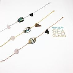 This is one beachy bracelet!!! A dainty 16k plated gold chain holds everything from the ocean: sea glass, abalone shell and a genuine shark's tooth!!! The sea glass is lavender purple and will darken in the sun over time!!! Each sharks tooth was found my me on the beaches of North Carolina!!! P
