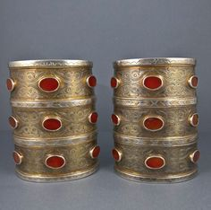 A pair of Turkoman cuffs that are signed and dated 1322 Hijri or 1904. From the Tekke people. With beautiful gilded details in the scalloped and chevron edging and the complex engraving.  In high grade silver with carnelian and weighing 515 grams.