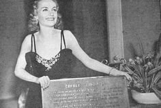 Carole holding the plaque that would be installed on her childhood home in Fort Wayne.