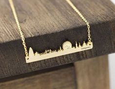 Click through for London themed gift ideas on Etsy, including this dainty London skyline necklace.