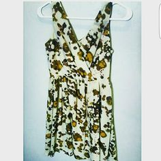 Empire waist floral dress!?? Cream-based floral dress. V-shaped front and back with a flowy material for shift and shaping. Dresses