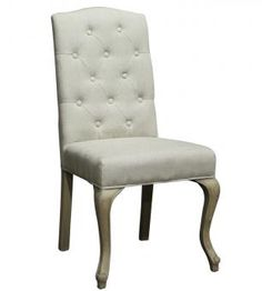 Create an authetic dining area with this beige upholstered Aimee dining chair with button tufted backrest that guests rarey would want to leave. Furniture, New Furniture, Accent Chairs, Interior, Home Furniture, Dining Stools, Trending Decor, Dining Chairs, Upholstered Chairs
