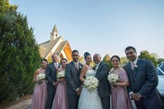 Gorgeous Emma's bridal party in Dust Me Pink coloured Goddess By Nature Signature Ballgowns and the groomsmen in their matching Dust Me Pink Mens Ties too!