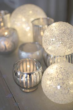 Arrange a festive table or mantle using a scintillating set of silver decor to brighten your event! Pictured with a variety of silvered votive candle holders and our 6 inch round sequined LED sphere, sold separately.