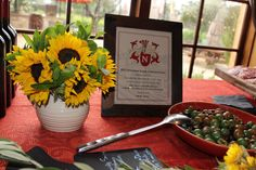 Sunflowers placed in rustic pitchers and each wines tasting notes were placed in rustic frames