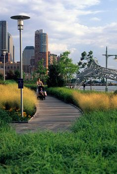 Hudson River Park – Tribeca Section/Pier 25 opens to the public mathews nielsen landscape architecture hybrid park new york walkway timber wood