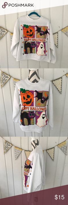 Happy Halloween Glitter Graphic Sweatshirt How fun is this Halloween sweatshirt?!  Features glitter graphics with a Jack o' Lantern, black cat, ghost, and bat. It is in good used condition. The sweatshirt has been washed several times, and there is some pilling as a result of this. Also, there is a stain on one of the sleeves. The stain is not noticeable when wearing. This sweatshirt is super cute and is perfect to keep you warm throughout October! Happy Halloween! 🎃 Halloween Tops…