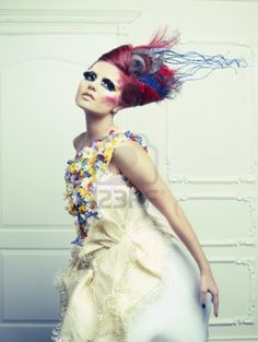 Avant-garde hair and bright make-up....runway high fashion or designer advertisement look