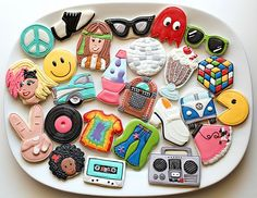 Four decades of cookies from Sugarbelle:  50's, 60's, 70's, 80's!  Adorable!