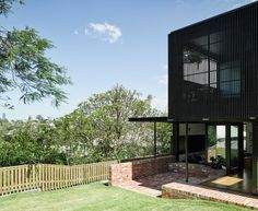 Paddington House is a private residence recently completed by Brisbane-based Kieron Gait Architects. The idea of the long hallway connects . Architecture Awards, Residential Architecture, Modern Architecture, Black Exterior, Exterior Design, Interior And Exterior, Outdoor Rooms, Outdoor Living, Recycled Brick