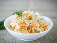 Win your next picnic or cookout with these easy coleslaw recipes. Find the best coleslaw recipes here, whether you like your slaw creamy or tangy. Simple Slaw Recipe, Chick Fil A Coleslaw Recipe, Coleslaw Recipes, Paleo Coleslaw, Carrot Slaw, Creamy Coleslaw, Sauerkraut Recipes, Cole Slaw, Salads