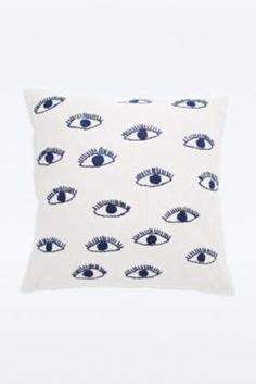 Kissenbezug mit aufgestickten Augen