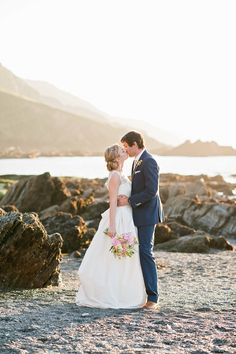 Image by Dominique Bader Photography - A coastal outdoor seaside wedding with  Stephanie Allin wedding dress and vintage styling and duck egg blue bridesmaid dresses.