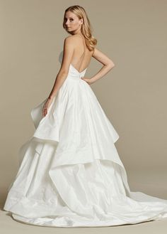 Ivory draped taffeta bridal ball gown, strapless sweetheart crossover bodice, cascading taffeta skirt with horsehair edging.