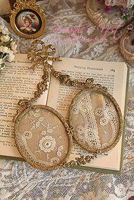 .frame tiny piece of heirloom needlework, locket, frame...