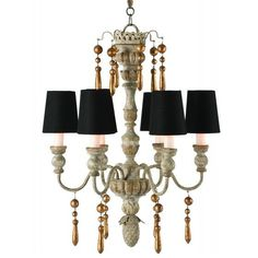The Grenoble Chandelier would not be complete without its black gold-lined shades! The gold lining on the inside of the shades help balance the gold dangles that adorn the arms. Chipped Creams found along the hand-carved center pole glow warmly when this chandelier is lit. If black is not your color of choice, we've included a set of linen shades for you as well.
