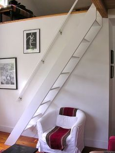 9 ladder steps to loft (relatively short wall height and higher-than-standard rise)... fixed standard hand rail... option~ use attic style mechanism to lift out of the way