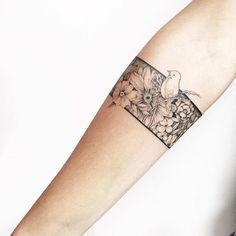 Image result for flower tattoo wrap around wrist
