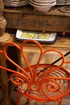 orange by wood & wool stool, via Flickr
