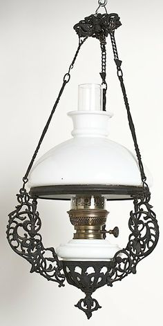 A hanging oil lamp with an iron frame; ht. 24 in.