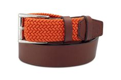 THE ARANCHO | Have some fun with the Arancho. Intricately woven elastic in our signature Albartross orange melds with chocolate brown Italian calfskin, finished off neatly with a traditional silvertone buckle. #luxurygolf #luxurybelts #golfshoes #modernluxury #leatherbelts #wovenbelts