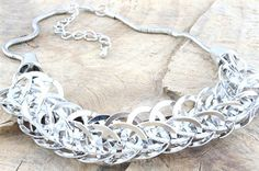 61269 Silver circles necklace  £35.00 incl tax  Metal necklace made up of entwined circles to give a 'floating' effect.  Length - approx 45cms with an additional 7cm extension.