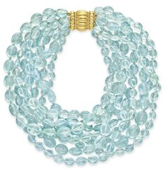 Verdura - An aquamarine bead necklace - Comprising eight strands of variously-shaped aquamarine beads, joined by an 18k gold clasp, mounted in 18k gold, 16 ins., two strands deficient, signed Verdura.