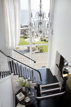 white-staircase-design - Home Decorating Trends - Homedit White Staircase, Staircase Design, Black Stairs, Grand Staircase, House Staircase, Black Railing, White Hallway, Staircase Landing, Foyer Design