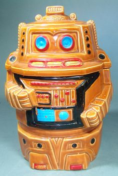 This terrific robot cookie jar was made in Japan and is circa the 1960's. In good condition with the usual crazing and paint wear that can be expected with age. The cookie jar measures around 9 inches
