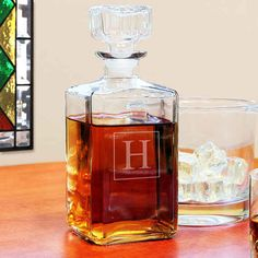 A whiskey decanter with personalization.