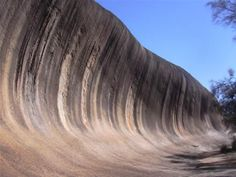 Wave Rock  Wave Rock, one of the most famous landmarks in Western Australia, is located near Hyden, a small town 350 km east of Perth. Resembling a giant wave just about to break, Wave Rock is 15 meters high and 110 meters long. It formed 60 million years ago, through chemical weathering of the granite, below Earth's surface.