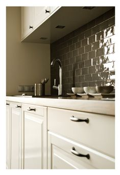 gray is the new white these days and I luv how this pic features the luscious gray subway tile back splash--it's a very traditional tile, with a little spice of color.