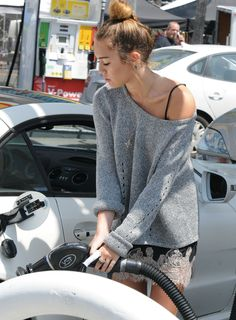 big sweater over a slinky dress #MileyCyrus